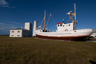 The new Garðskagaviti lighthouse and a boat that has been restored and is open to the public.