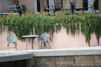 table and chairs by the canal