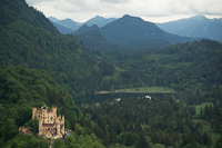 Hohenschwangau Castle, Schwansee and the Austrian Alps in the distance