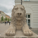 smiling lion statue in Warsaw