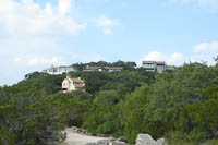 houses on the hill behind Mt Bonnell